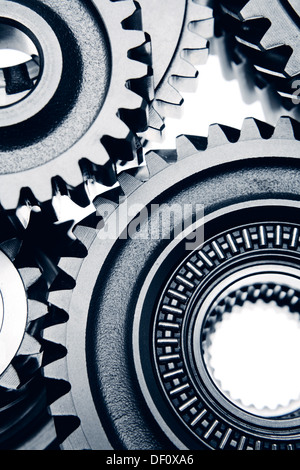 Metal cog wheels bonding together - Stock Photo