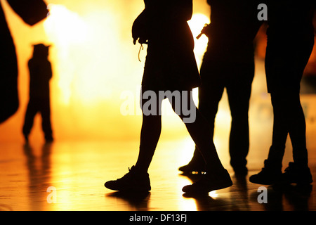Berlin, Germany, silhouettes of legs - Stock Photo
