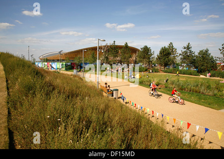 View through Queen Elizabeth Olympic Park to the Velodrome, Stratford, London, UK - Stock Photo