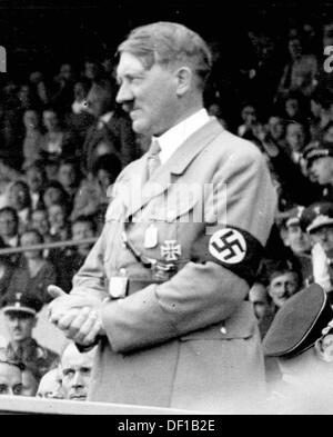 The image from the Nazi Propaganda! shows Adolf Hitler with a swastika armband at a public event. Date and place - Stock Photo