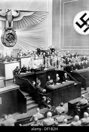 The image from the Nazi Propaganda! shows Reich Chancellor Adolf Hitler delivering a speech in the Kroll Opera House - Stock Photo