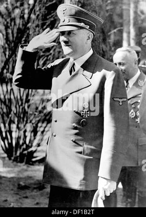 The image from the Nazi Propaganda! shows Adolf Hitler in uniform doing the Nazi salute in 1944. Photo: Berliner - Stock Photo