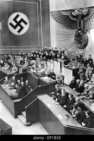 The image from the Nazi Propaganda! shows Reich Chancellor Adolf Hitler delivering a speech to the Reichstags in - Stock Photo