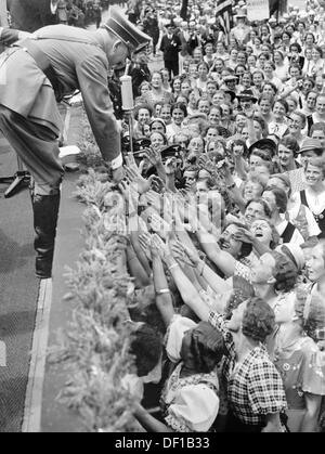 The image from the Nazi Propaganda! shows Adolf HItler surrounded by cheering women. Date and place unknown. Photo: - Stock Photo