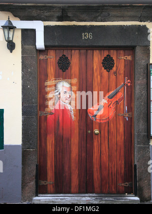 Madeira, Funchal, painted doors in the old city, The art of open doors in the street of Santa Maria - Stock Photo