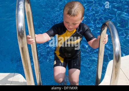 Boy Getting Out Of Swimming Pool Stock Photo Royalty Free Image 88108566 Alamy