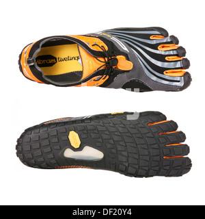 Vibram FiveFingers spyridon ls are barefoot running shoes isolated on white background. - Stock Photo