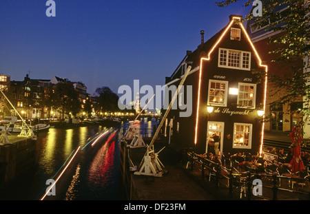 Café de Sluyswacht, Oudeschans, Amsterdam. Holland - Stock Photo