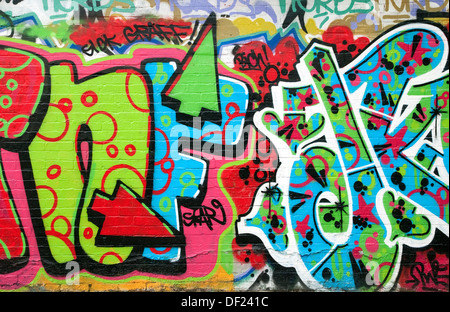 colourful graffiti on urban city wall, norfolk, england - Stock Photo