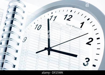 Clock face and year planner - Stock Photo