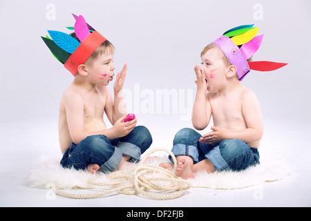 Young Indian boys with fancy colorful hats - Stock Photo