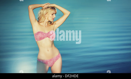 Cute blonde lady wearing nice swimsuit - Stock Photo