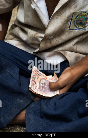 Young poor lower caste Indian street boy begging for money. Andhra Pradesh, India - Stock Photo