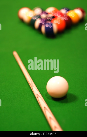 Billiards Balls And Cue On Pool Table - Stock Photo