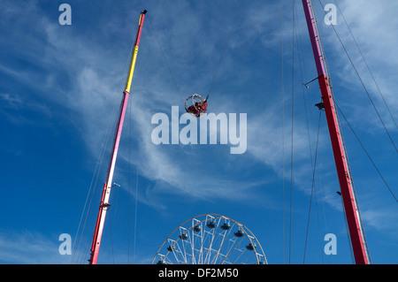 Slingshot ride in action on Boardwalk in Ocean City, Maryland - Stock Photo