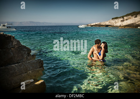 Attractive young couple enjoying their long honeymoon - Stock Photo