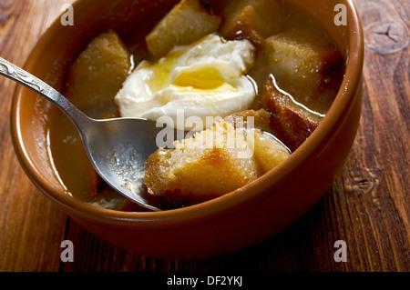sopa de ajo , castilian garlic soup.farm-style - Stock Photo