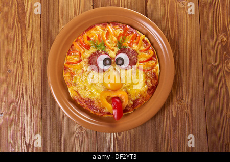 Smiley Faced Pizza.Baby menu - Stock Photo