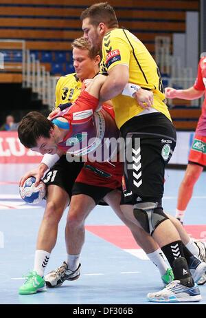 Hamburg's Matthias Flohr (C) is stopped by Velenjes'  Kristian Beciri (R) and Janez Gams during the handball Champions - Stock Photo