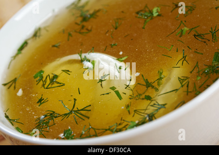 Chicken broth with dill and egg.closeup - Stock Photo