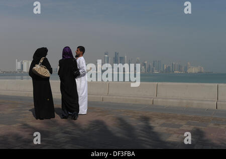 (dpai-file) A file picture dated 06 January 2011 shows two local women and a man standing on the harbour promenade - Stock Photo