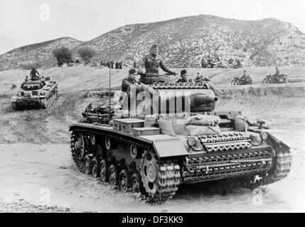 The image from the Nazi Propaganda! depicts soldiers of the German Wehrmacht with tanks at the front in Tunisia, - Stock Photo