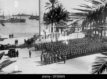 The image from the German Propaganda! depicts a formation of German soldiers in Tripoli, Libya, published on 21 - Stock Photo