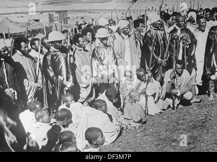The image from the Nazi Propaganda! depicts local men and children with weapons in Ethiopia, published 20 November - Stock Photo