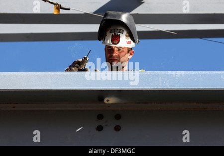 Iron worker welding on construction site - Stock Photo