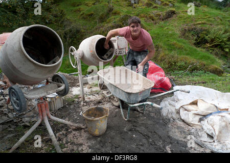 Llanwrda, Wales UK Fri 27th Sept 2013. 22 year old Carl Evans of Ammanford, a fully qualified plasterer, cleans - Stock Photo