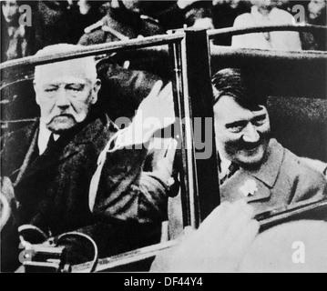 President Paul von Hindenburg and Chancellor Adolf Hitler in Car, Germany, 1933 - Stock Photo