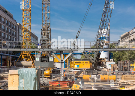 Construction site with workers for the realization of a new subway in the center of the city Berlin, Germany - Stock Photo
