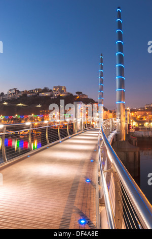 The modern Millenium Bridge at Torquay harbour, dusk. - Stock Photo