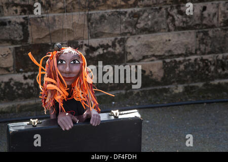 Scary, toy, doll, horror, halloween, spooky female puppet with long orange hair & suitcase at Skipton UK. 27th September, - Stock Photo