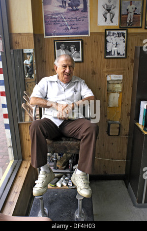 Barber in his shop in the afternoon. Calle Ocho, Little Havana. Miami, Florida. USA - Stock Photo