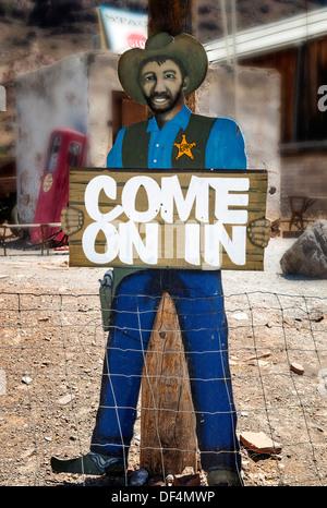 Come on In,a folk art cowboy sheriff cutout in down town Oatman Arizona - Stock Photo