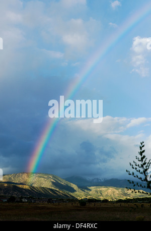 Rainbow over the Rocky Mountains, just outside Salida, Colorado, USA - Stock Photo