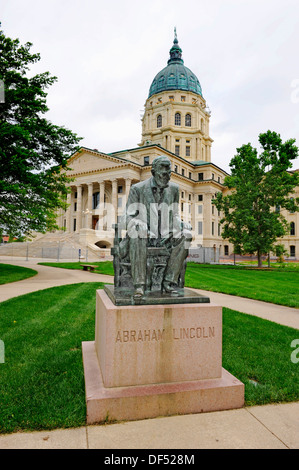 Statue of Abraham Lincoln in front of state capitol Topeka Kansas - Stock Photo