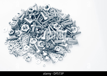 Pile of nuts and bolts on plain background - Stock Photo