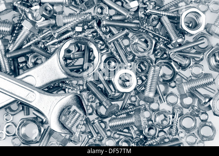 Spanners on nuts and bolts - Stock Photo