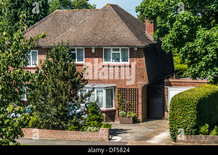 A period (1930s) detached house, typical of the area in Banstead, Surrey, UK. - Stock Photo
