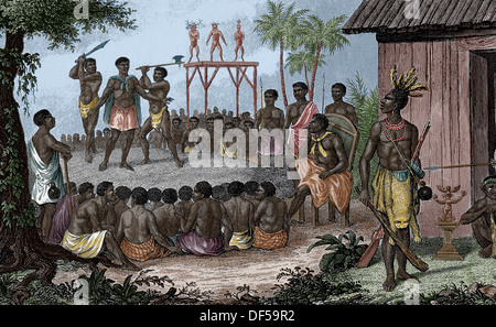 West Africa. Human sacrifices of the Cassange negroes. Guardian. Engraving. (Later colouration) - Stock Photo