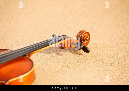 Violin on sandy beach. Love of music concept - Stock Photo