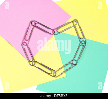 Note paper and paper clips in the shape of heart - Stock Photo