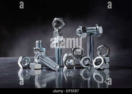 Still life with nuts and bolts. - Stock Photo