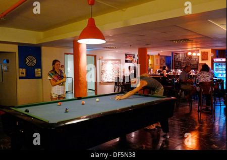Young tourists playing billiard in Abraham hostel in West Jerusalem Israel - Stock Photo