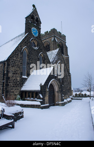 Cold, grey winter scene with snow falling on St. John's Church (building & path covered with white layer) - Baildon, - Stock Photo