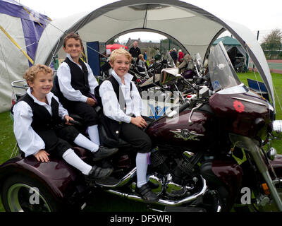 Llandovery, Wales, UK. Sat 28th Sept 2013.  Boys from Menter Bro Dinefwr have a break from the traditional Welsh - Stock Photo