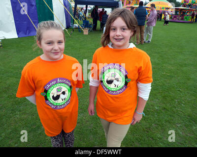 Llandovery, Wales, UK. Sat 28th Sept 2013.  Friends Kayla Davies and Faith Davies wear festival tshirts at in Castle - Stock Photo