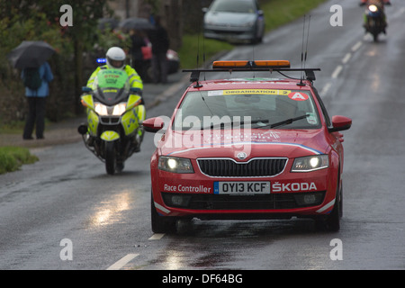 Support vehicles following the the Tour of Britain Road Cycling Race as it nears the end of the Cumbrian stage in - Stock Photo